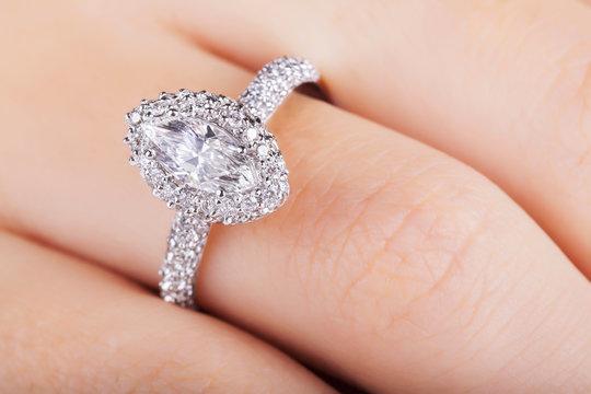 Close up of elegant diamond ring. Close up of elegant diamond ring on the finger. Diamond ring.