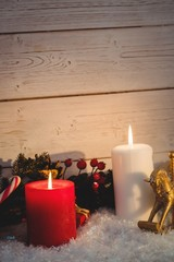 Christmas decorations against wooden wall