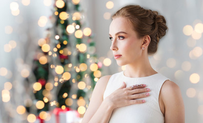 woman wearing diamond jewelry for christmas