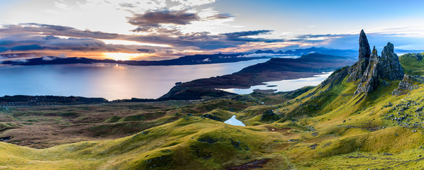 Sunrise at the most popular location on the Isle of Skye - The Old Man of Storr - beautiful panorama of an amazing scenery with vivid colors and picturesque panorama - symbolic tourist attraction