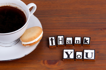 Thank You. On wooden table coffee mug, cookie