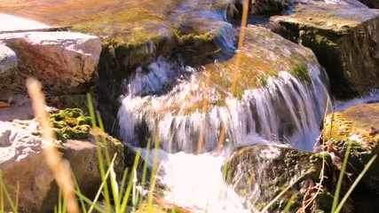 Wall Mural - Small creek with waterfalls in the Autumn