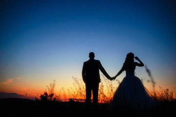 Couple in love silhouette during sunset