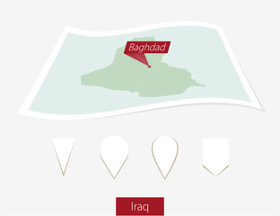 Curved paper map of Iraq with capital Baghdad on Gray Background