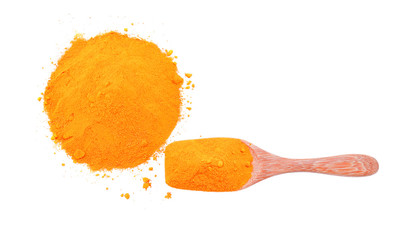 Turmeric, saffron powder, turmeric powder on a wooden spoon isol