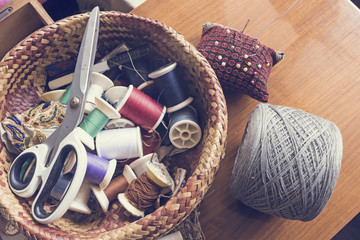 threads and scissor in basket
