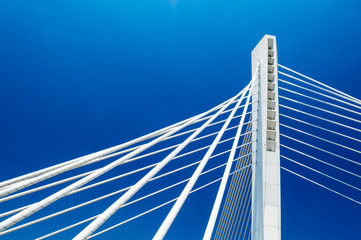 Wonderful white Millennium bridge structure over clear blue sky in Podgorica, Montenegro