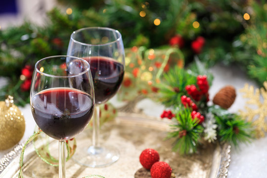 Red wine glasses on snow