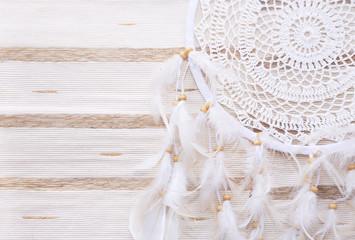 Dreamcatcher on a beige background