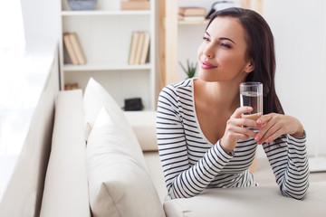 Pensive girl enjoying fresh beverage