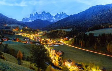 Wall Mural - Santa Maddalena village, night scene, Dolomites mountains on background. Italy, South Tyrol.