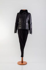 Black jacket with zipper on one side and black pants