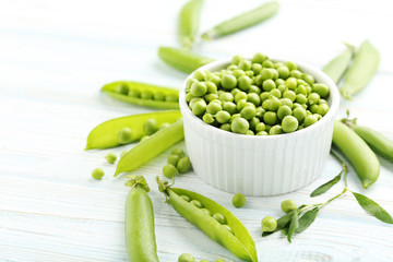 Green peas on a blue wooden table