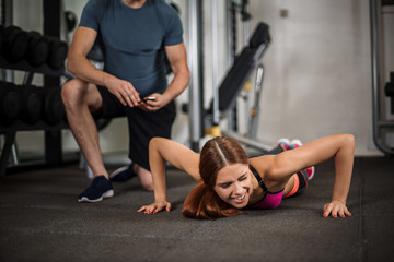 athletic girl performs push-ups