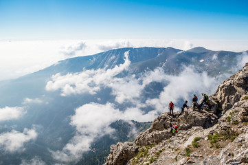 OLYMPUS NATIONAL PARK, GREECE - JULY 11, 2015: Tourists climbing the Olympus mountain in Greece.