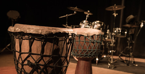 Traditional wooden african djembe drumon stage