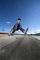 Skater jumps high in air