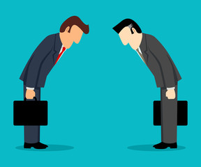 Two businessmen bowing each other
