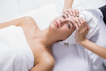 Young woman enjoying facial massage at spa salon.Facial massage