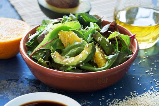 Fresh salad with avocado and orange