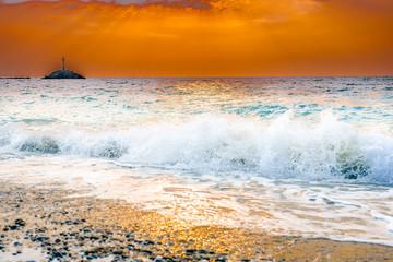Waves that break down the Greek coast when the sun goes down