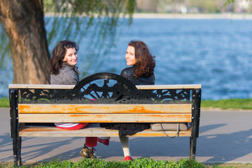 Best friends sitting on a bench
