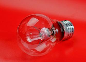 Halogen light bulb on a red background