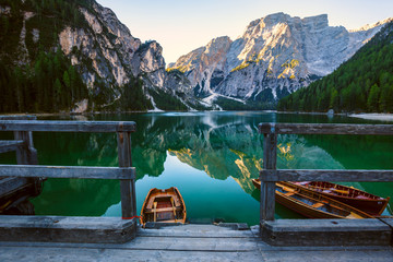 Boats on the Braies Lake ( Pragser Wildsee ) in Dolomites mounta Wall mural