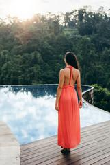 Female model in sundress at poolside