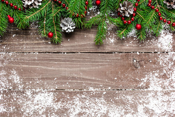 Christmas wooden background with snow fir tree and decorations