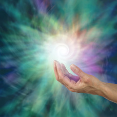 The Infinite Spiral of Life - open palm with a bright white spiraling light form floating above  expanding outwards on a green and purple ethereal energy background