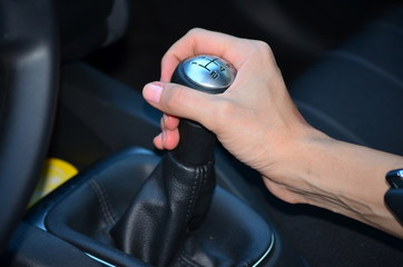 woman hand on manual gear shift knob