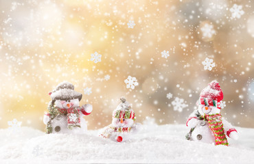Christmas snowmen on abstract background