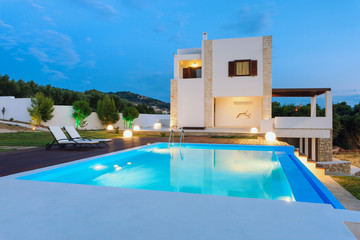 big luxury pool with villa