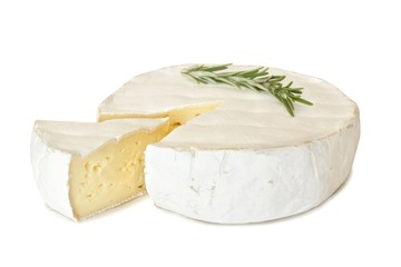 Brie cheese with rosemary and cut slice isolated on a white background