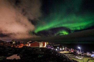 Northern lights over Nuuk streets, Nuuk city, Greenland