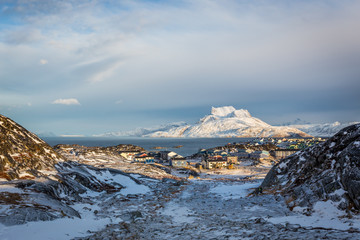 Daylight view to the distant suburb of Nuuk, Sermitsiaq mountain