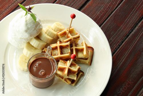 "Waffle and banana chocolate fondue"" photo libre de droits sur la ..."