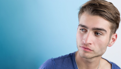 Portrait of an handsome young man with interesting  background a