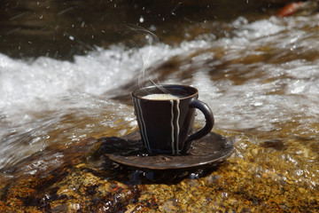 Refreshments and coffee on the rocks at the waterfalls.
