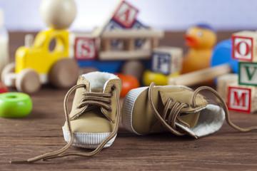 Children's World toy on a wooden background.