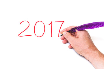 2017. Hand writing numbers purple pen on white background
