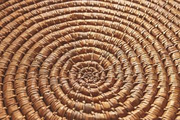Circular background from natural brown rattan fibers