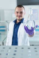 young doctor scientist in bright labaratory work research and an