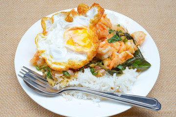 fried shrimps with chilli paste and basils, rice and fried egg topping