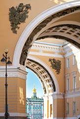 St. Petersburg. Details of the beautiful architecture of the city. View through the  triumphal arch of the General Staff Building on Palace Square and the Winter Palace