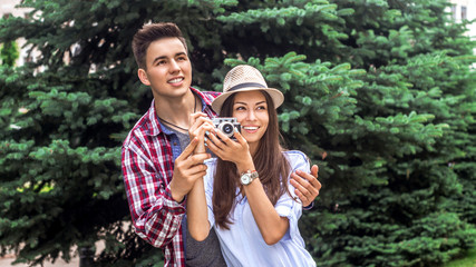 Taking some stunning holiday pics. Shot of a young couple taking photos while enjoying a city.