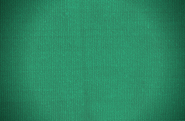 Natural background of thick green fabric. Fabric texture  for background. Vignette background