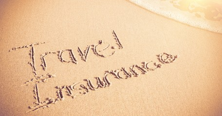Travel Insurance written on sand