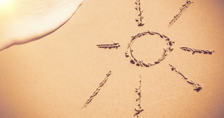 Sun drawn on sand